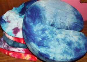 Hand-dyed covers for massage table face cradle cushions